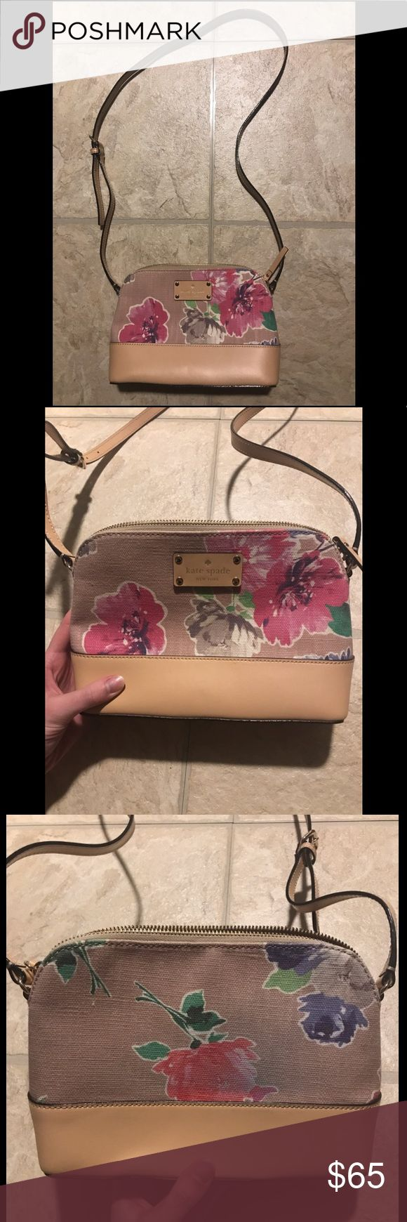Kate Spade Floral Crossbody Bag Kate Spade Floral Crossbody Bag. Perfect condition except jean wash stain on the back of the bag (pictured). kate spade Bags Crossbody Bags