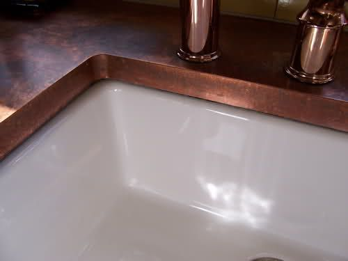 yep. This confirms it. I want copper sheeting over my laminate counter tops. In this series of pics they are really using their counters with messes and water and it looks goregous!