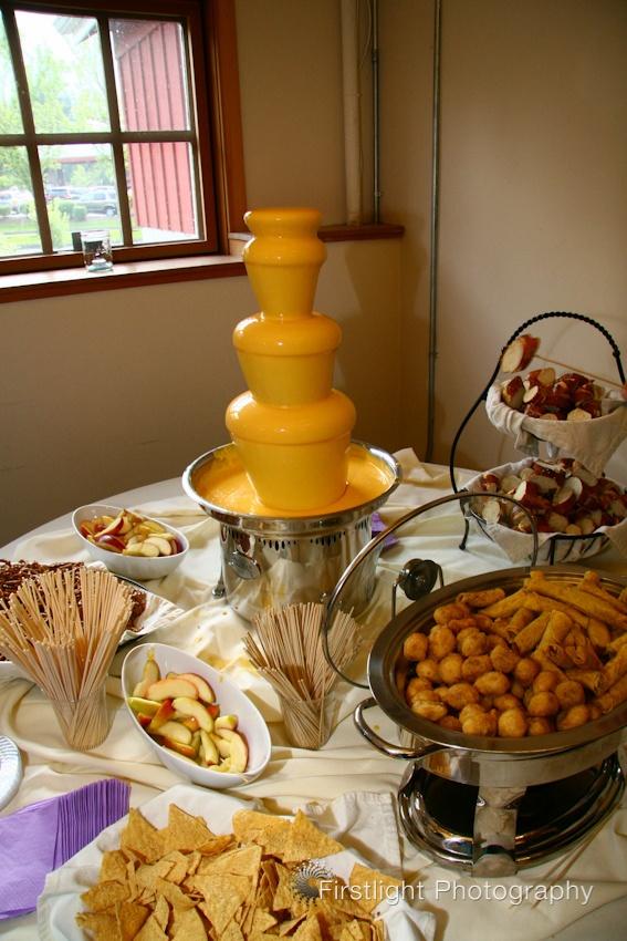 Nacho cheese fondue fountain    Puyallup-wedding-photographer-nacho-cheese-fountain.jpg 567×850 pixels