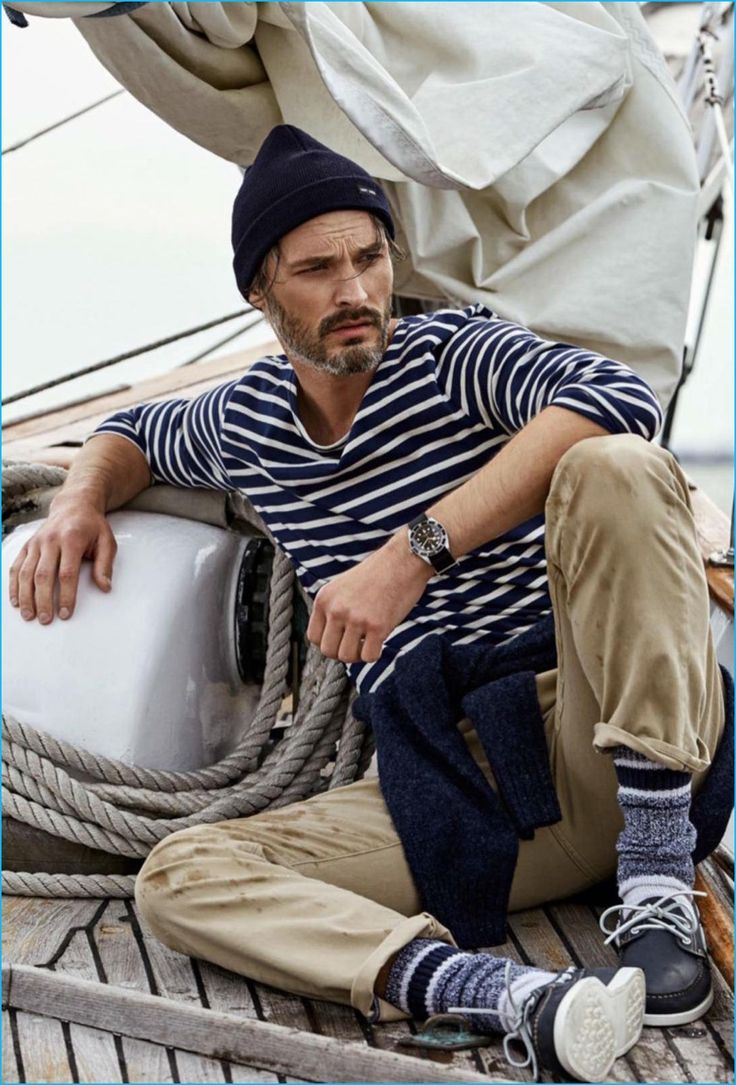Ben Hill pictured in a striped pullover from Uniqlo with Dockers pants for GQ France.