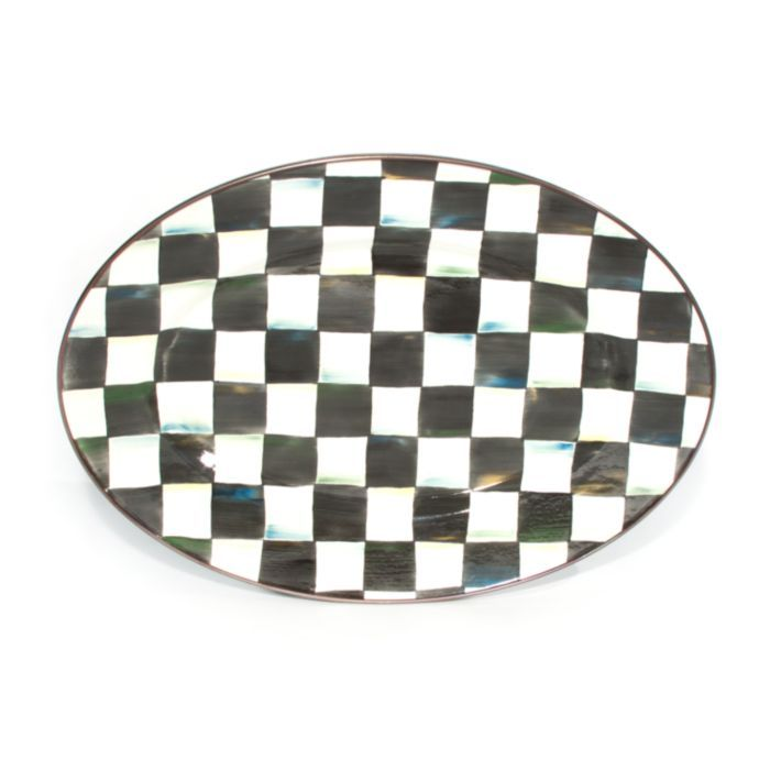 A welcome gift for the Courtly Check® collector, the Small Courtly Check® Enamel Oval Platter is a great addition to the dinner or buffet table. Hand-painted checks reveal a spectrum of accent colors. Steel underbody and bronzed stainless steel rim.