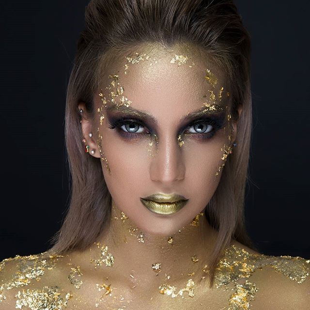 """GOLD FOIL MAKEUP • Model: @lulu.fantasya • Photographer: @alyasenq8 • Makeup Products Used • • @katvondbeauty Serpentina Eyeshadow Palette """"Medusa, Ankh, Queen"""" on the eyes and """"Project"""" on the lips and pretty much everywhere 😅 • @thekatvond Shade + Light Eye Contour Palette using my favorite black eyeshadow of all time """"Shax"""" and """"Succubus"""" to add some depth and intensity to the face contours and lips 🙄👾 #katvondbeauty #katvond"""