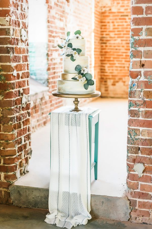 wedding cake table - photo by Photography by Angela Tucker http://ruffledblog.com/urban-botanical-wedding-inspiration