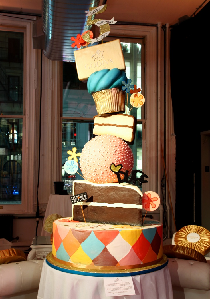 Chef Duff Goldman created a five foot cake for the SWEET! 5th Anniversary Party inspired by the new GODIVA Cake Truffle collection. Do you see the giant Birthday Cake Truffle? #NYCWFF #GODIVA