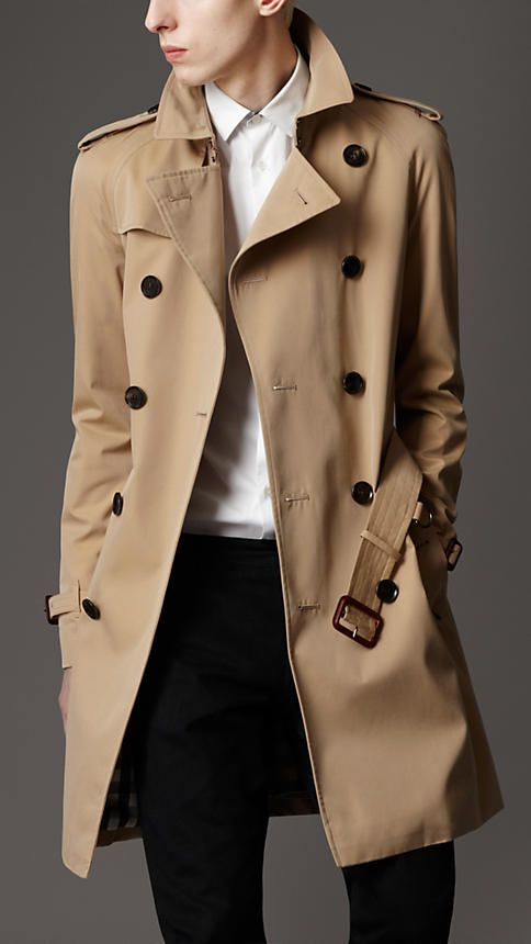 Every man should have a trench coat for business and travel and this slim, mid-length gaberdine trench from Burberry is a perfect fit for both.