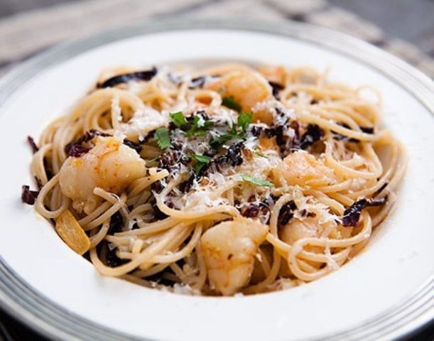 ANCHO CHILE, SHRIMP, PASTA:......  *8 oz. long, thin pasta such as spaghetti or fettuccini; * 1/2 cup vegetable oil (grape seed or canola); *3 thinly sliced cloves garlic; * 1 oz. (about 2 med/lg.) dried ancho chiles, rinsed, seeded; * 1/2 lb (21-25) raw shrimp, peeled, deveined, tails removed, cut; * Black Pepper  Sea Salt; * Freshly grated Parmesan; *Lime or lemon juice, fresh squeezed