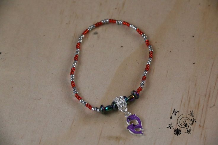 Red and Silver seed beads with  a charm of two purple playful dolphin. A beautiful addition to you Spring/Summer  wardrobe. by DelightGalleryCrafts on Etsy