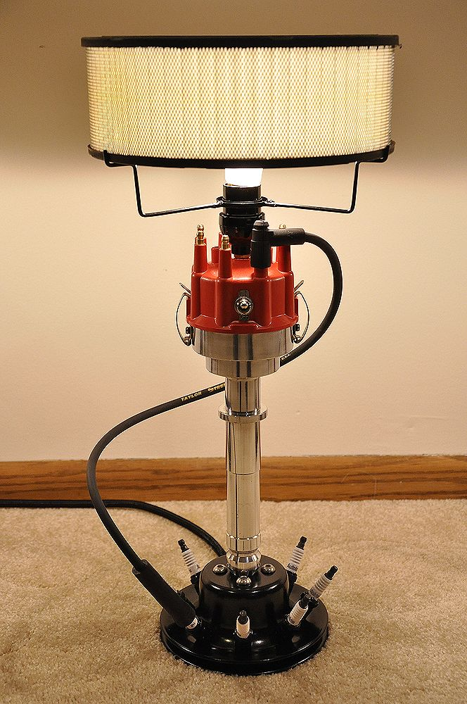 These lamps are built one at a time by a true car guy. They are built using real car parts. It features a billet car distributor. The base is made from a car