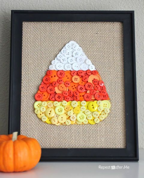 Glue orange, white, and yellow buttons to burlap in a candy corn pattern for a bright mantel art.  Get the tutorial at Repeat Crafter Me.
