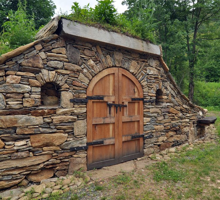 Gorgeous stone faced root cellar with custom door.