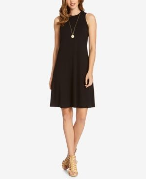 A classic A-line dress from Karen Kane lends itself to bold accessories and statement heels. | Rayon/spandex | Machine Washable | Made in USA | High neckline  | Pullover; no closures | Sleeveless | A-