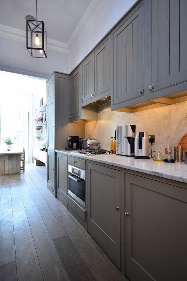 light, bright, and airy. nice grey kitchen with marble counters opens up to the bright white dining room and french doors in this beautiful London townhome