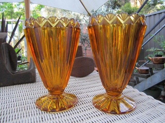 Stunning Pair Vintage Australian Art Deco Amber Depression Glass Vases Description Stunning Pair Vintage Australian Art Deco Amber Depression Glass Vases c1930's. Stunning examples, very rare to find a matching pair Please refer to the photos for condition. Pickup West Pymble, Sydney, 2073 Enquiries phone 0416 024 667 or email. Dimensions: 20cm high, 12cm wide