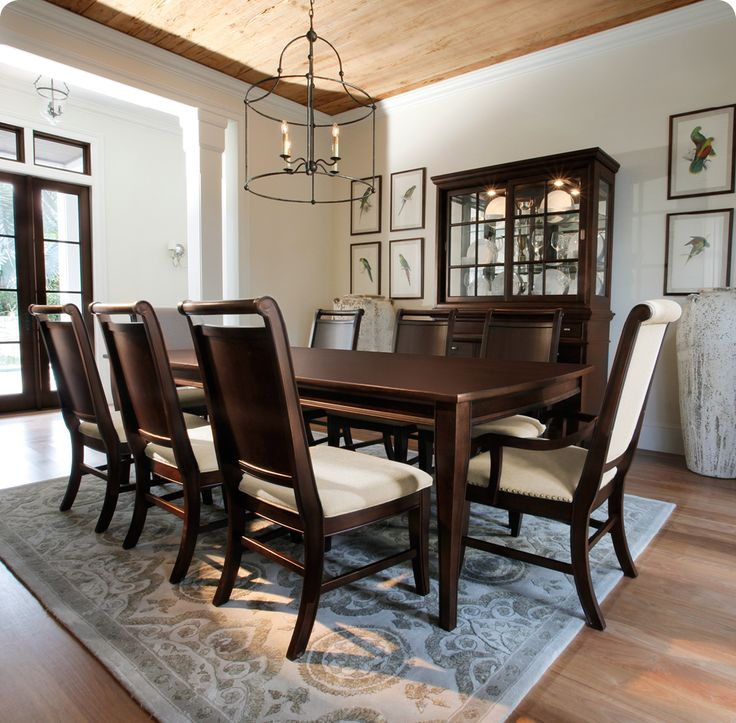 Dinner party perfection: A beautiful wood dining table and china cabinet.