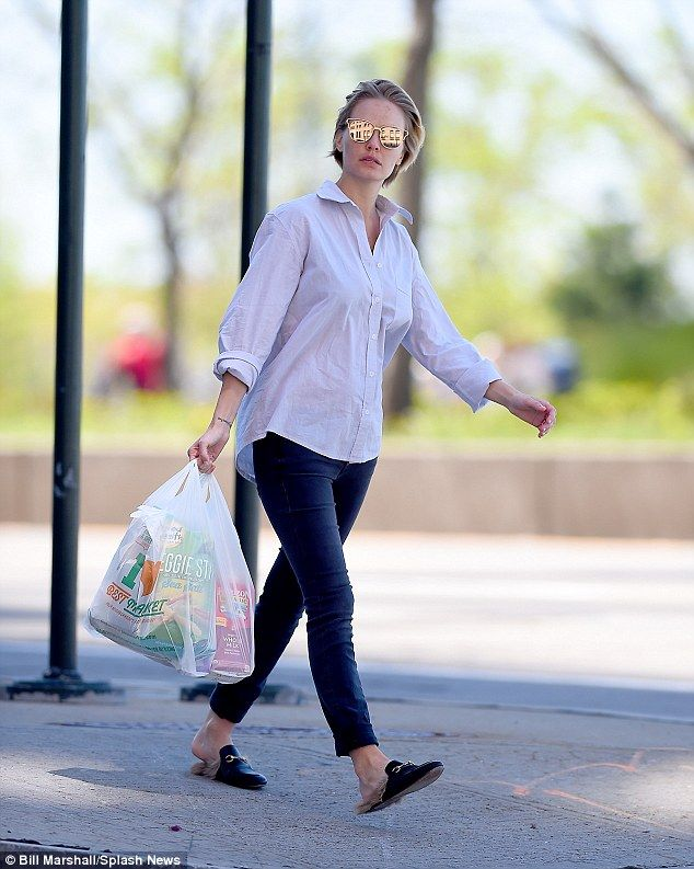 Trim and terrific! Lara Bingle was spotted buying Veggie Stix during a grocery shopping trip in New York on Monday