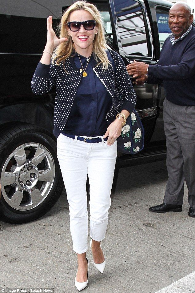 Fashionista on the fly: The smiling 39-year-old was impeccably dressed in a spotty cardigan over a blue shirt and white cropped jeans plus white high-heeled pumps