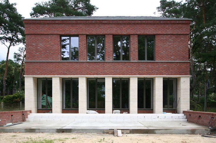 Klassisch traditionelles Einfamilienhaus aus Backstein und Naturstein - VOGEL CG ARCHITEKTEN BERLIN