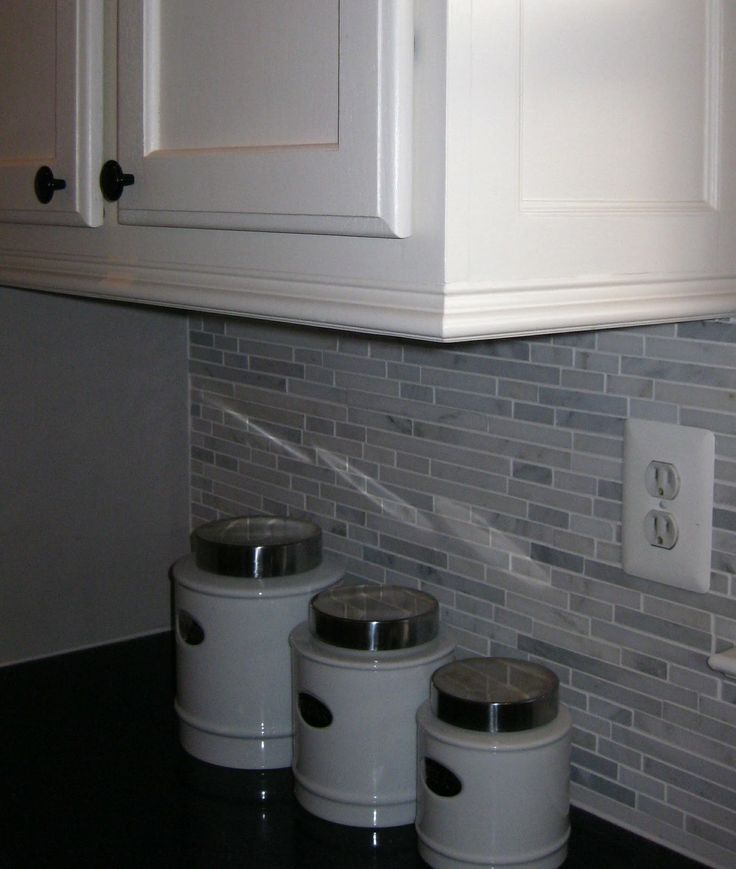 Crown Molding added to bottom of cabinets. I like this idea. Perfect to hide strips of light for underneath too.