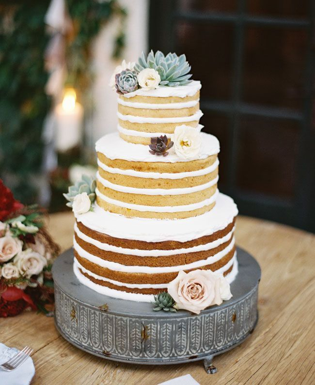 simple naked wedding cake with succulents