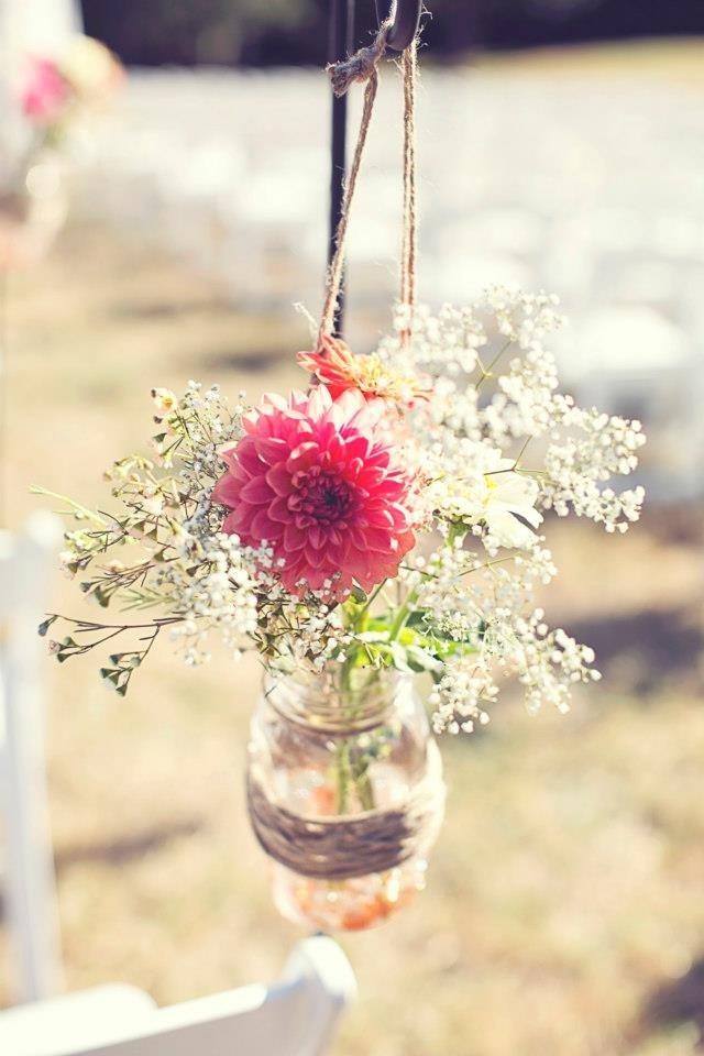 Flower in hanging mason jar