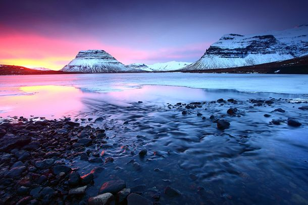 Grundarfjordur, Iceland- This small Icelandic town is situated between a mountain range and a lava field making for some intense background scenery as you watch the sun fall below the horizon.