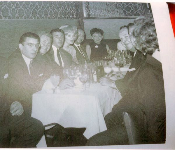 Ronnie and Reggie having dinner with Judy Garland and other friends.