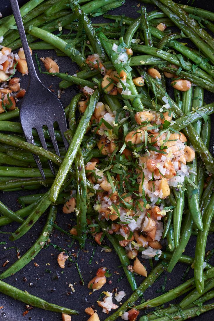 This simple almond-shallot topping goes with just about any simply cooked vegetable, but it tastes best with green beans Instead of simply blanching the beans, I char them until they develop a smoky richness.