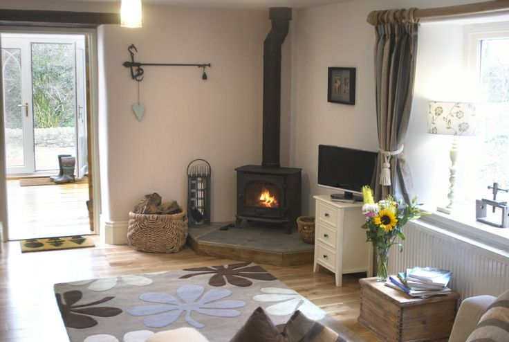 The Old Paper Mill has a quintessential country cottage log burner surrounded by a slate hearth. Ideal for warming up after a walk in the surrounding woodland.