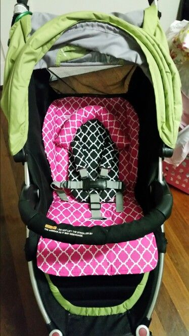 Pink and Black reversible pram liner with matching head support and strap covers