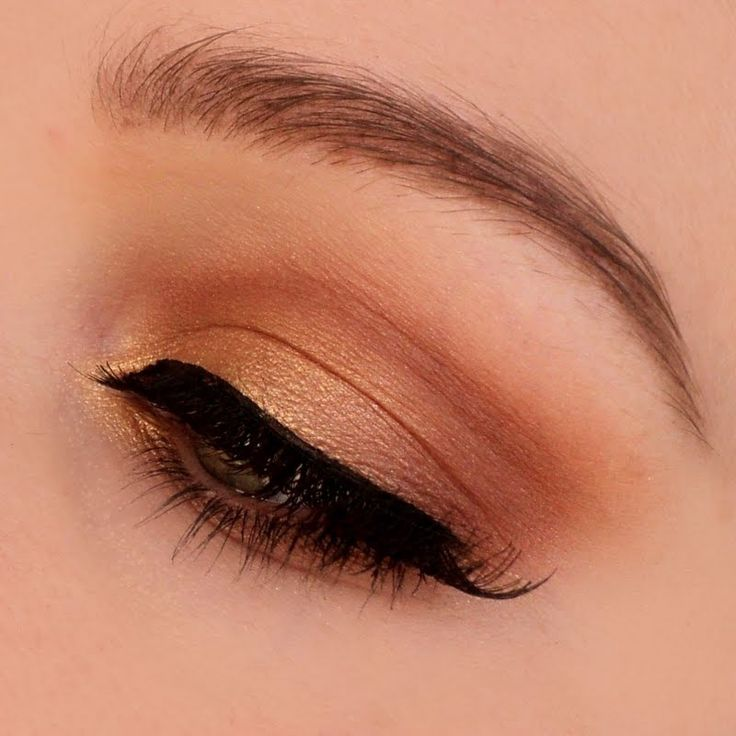Light matte and shimmery copper eyeshadow shades are used for a solid wash of color on the lids. DIY this beautiful eye makeup for an easy everyday look.