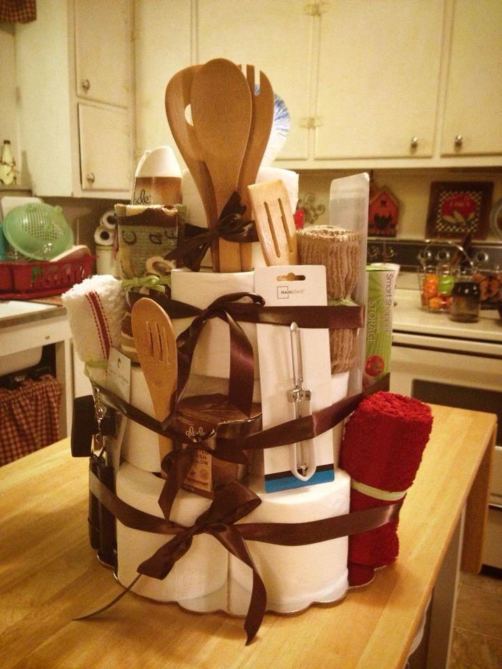 Housewarming cake. Toilet paper, kitchen utensils, bathroom supplies and ribbon! :)