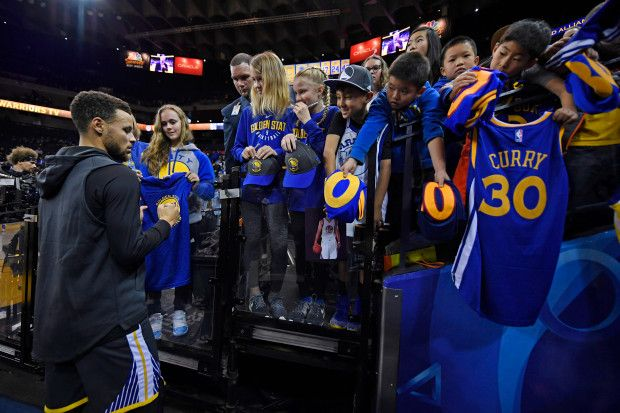 Golden State Warriors' Stephen Curry (30) signs autographs before the start of their NBA game at the Oracle Arena in Oakland, Calif., on Saturday, Dec. 30, 2017. Curry returns to the floor tonight after sustaining an ankle injury on Dec. 4th. (Jose Carlos Fajardo/Bay Area News Group)