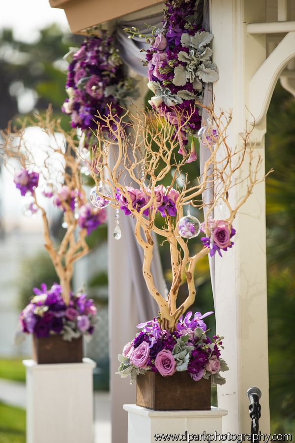 Manzanita Trees. Wedding ceremony flowers. Purple, grey, lavender. Roses, orchids, dusty miller, stock, calla lilies, lisianthus. Florals by Jenny