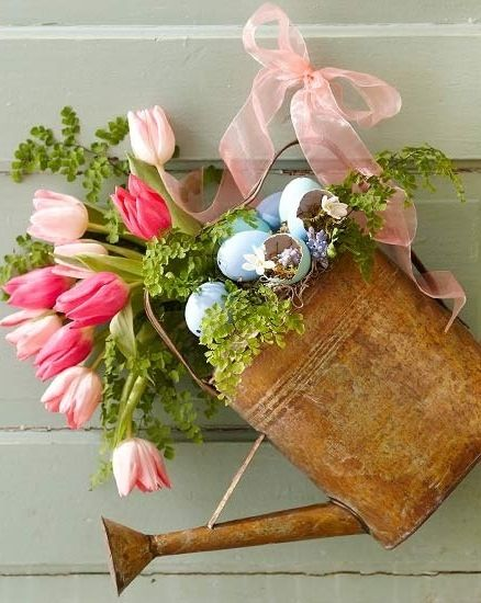 Easter/spring decorations - tulips and eggs in a watering can -- Repinned by Beneva Flowers #Sarasota Florist