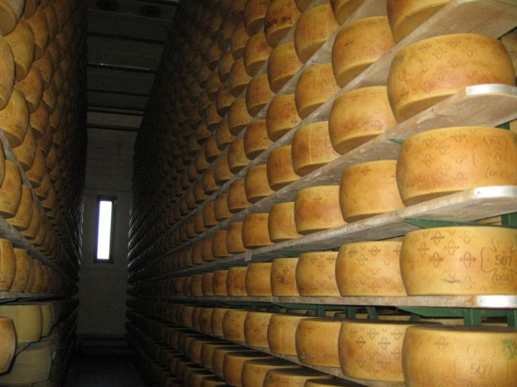 """The word Grana means """"grainy"""" or """"granular"""", this is how the cheese looks when it is cut open. Grana Padano, an Italian cow's milk cheese would be easily recognized for another reason - the wheel is enormous, usually ranging from 70 to 88 pounds. Grana Padano is aged a minimum of 18-months. It carries a mark on the cheese. Look for the Zanetti mark to ensure you are buying the best. Grana Padano could be called the body builder. It is low in fat and very high in protein and calcium"""