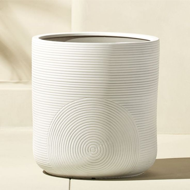 Shop zen large white planter.   Graphic thumbprint design ups the modern appeal on this glossy clay planter.  Large scale vessel pairs perfectly with our Zen white planter for a classic black and white vibe.