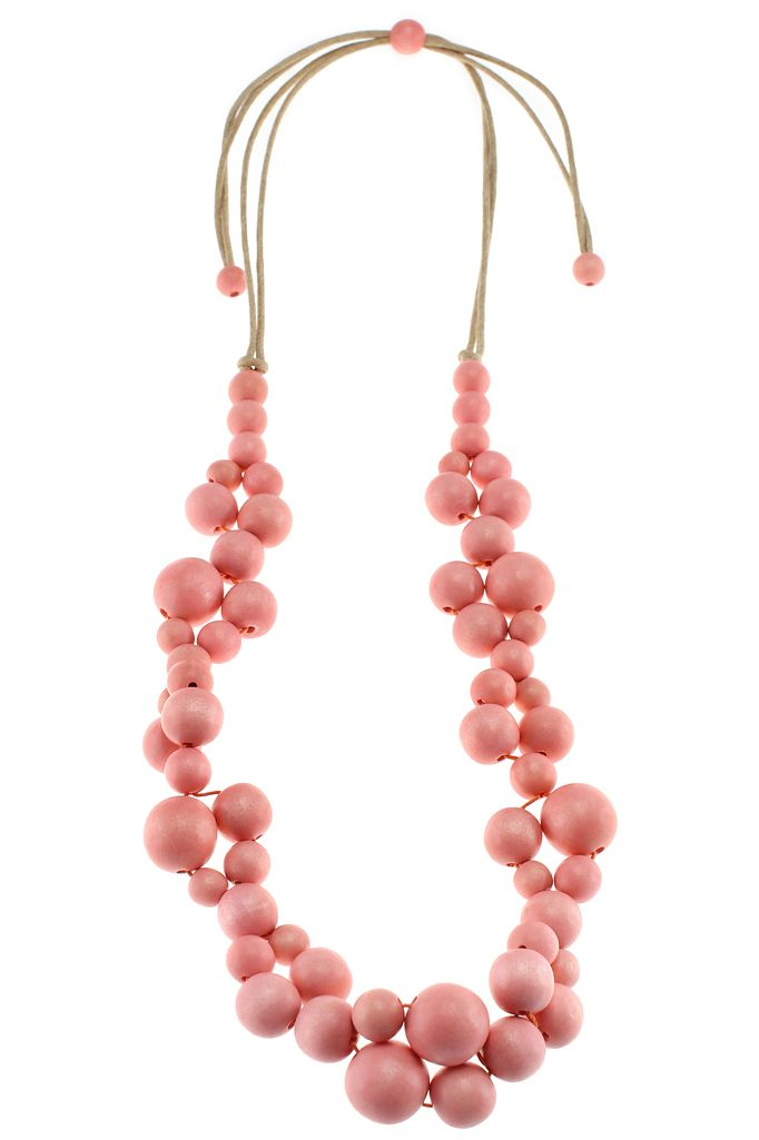 Sea Flower necklace - Coral. Our chic single-strand wooden Sea Flower necklace looks stunning worn day or night. Large wooden beads are strung together to create a necklace that is lightweight and elegant. It comes in three shades; natural, coral and aquarelle and each has a matching a bracelet. It has been handmade and is on an adjustable cord, so it can be worn at any length. Wooden necklace on cord Adjustable length, 440mm (max)  lucyandalice.com.au