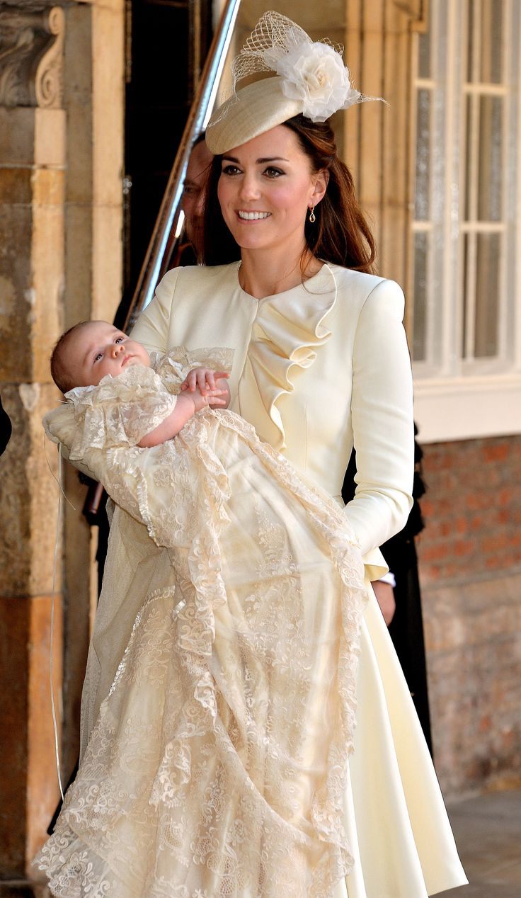 Kate wore Alexander McQueen for baby George's Christening day, an ivory dress that matched her son's christening gown perfectly. via StyleList