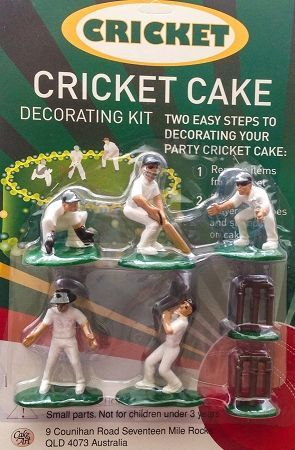 Cricket player figurines and cricket stumps for a cricket themed cake