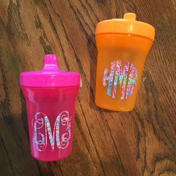 Lilly Pulitzer Vinyl Monogrammed Sippy Cups  Sippy Cups are 8oz Spill-Proof Cups and BPA-Free You can choose between pink or orange cup.