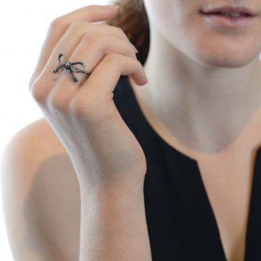 A delightful hand-tied bow!  STRING BOW RING - black rhodium £110.