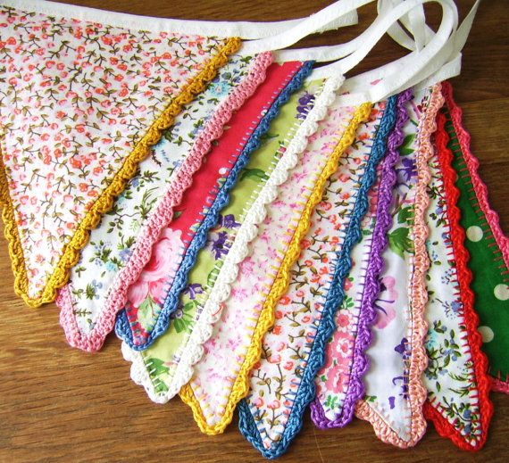 Gorgeous handmade bunting. Made of new and vintage cotton fabrics in bright colours. Each flag is finished with a crochet edging of new and