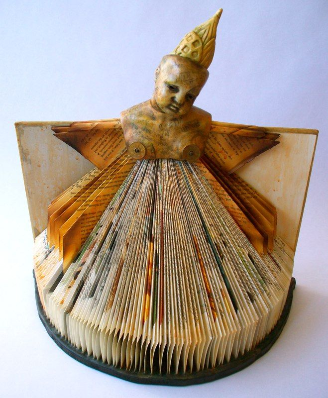 'words' by American artist Marie EvB Gibbons. Porcelain doll bust, altered book, found & made objects, beeswax. via the figurative art beat