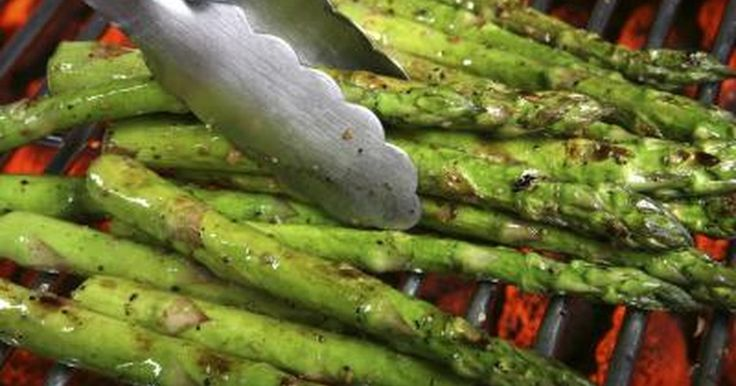 Grilled asparagus adds flavor to the vegetable that you can't get indoors. The resulting asparagus makes a much more appealing side dish than the mushy asparagus that often comes from steaming the vegetable. The foil acts as a barrier to the direct heat of the grill and prevents you from losing a thin spear through the grate of the grill....