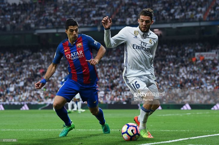 Luis Suarez of FC Barcelona competes for the ball with Mateo Kovacic of Real Madrid CF during the La Liga match between Real Madrid CF and FC Barcelona at the Santiago Bernabeu stadium on April 23, 2017 in Madrid, Spain.
