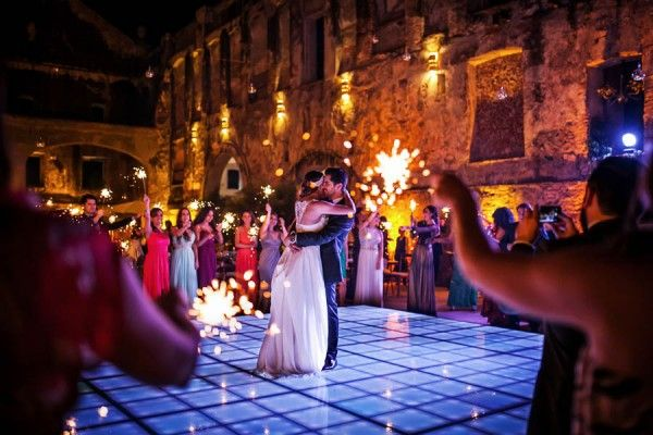 Guests holding sparklers during the first dance. How romantic!