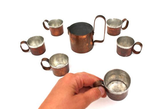 Copper shot glasses Copper drinking set Rustic copper home decor Vintage copper.  Vintage copper shot glasses and a small jug/pitcher set in good vintage condition. The handmade set comes from 1960´s from Estonia.  It would be possible to clean the copper so it would shine like new but I myself prefer this rustic and used looking copper, so I let the set´s new owner decide what to do with it. All of the shot glasses are 1.6 inches tall (4 cm), diameter of their openings is 2 inches (5 cm...