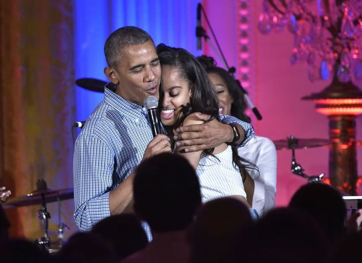 Obama hugs his daughter Malia on her birthday during an Independence Day celebration on July 4 at the White House.