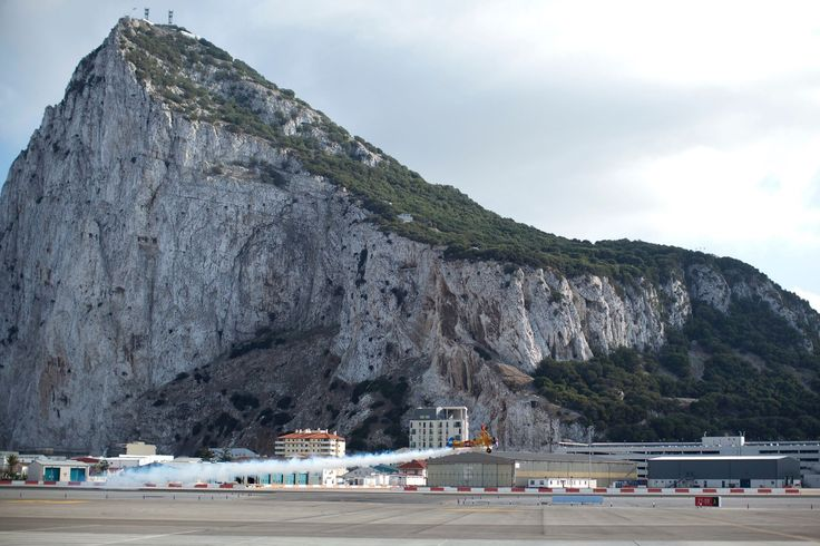 ROCK OF GIBRALTAR (GIBRALTAR) This monolithic limestone promontory is located in the British Overseas Territory of Gibraltar. The upper reaches of the rock are covered by a natural reserve, which is inhabited by hundreds of Barbary macaques—a prime attraction for tourists.