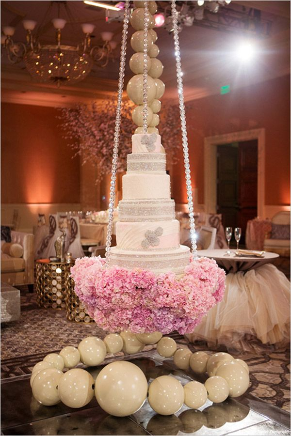 tamra barney wedding cakeSuspended Cakes  Real Housewives of Orange County star Tamra Barney also opted for a suspended wedding cake at her June 15 wedding. Instead of hanging it upside-down, wedding planner Diann Valentine created a platform surrounded by floating pearls for the cake to rest on. A quilted pattern and edible crystals made for a lavish look!
